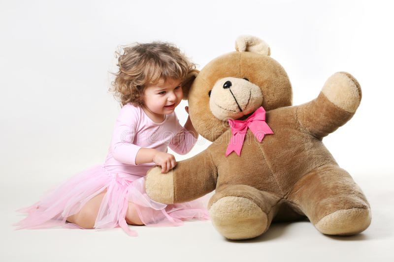 little girl is talking with her teddy royalty free stock photos