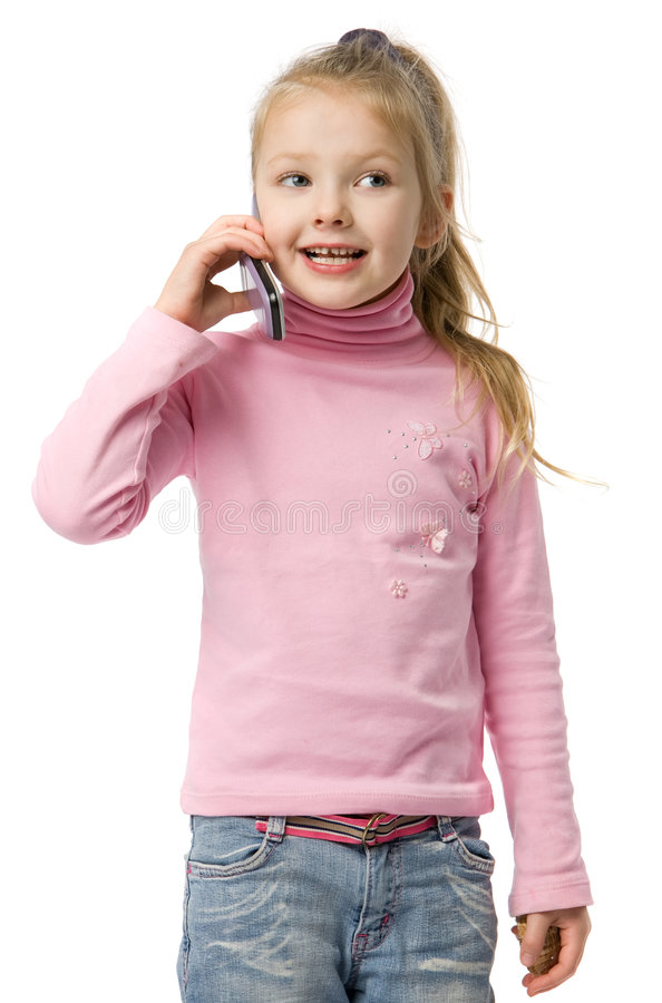 Little girl talks by mobile phone stock images