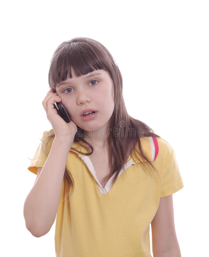 The little girl talks by a mobile phone. Surprise. Isolated object stock images