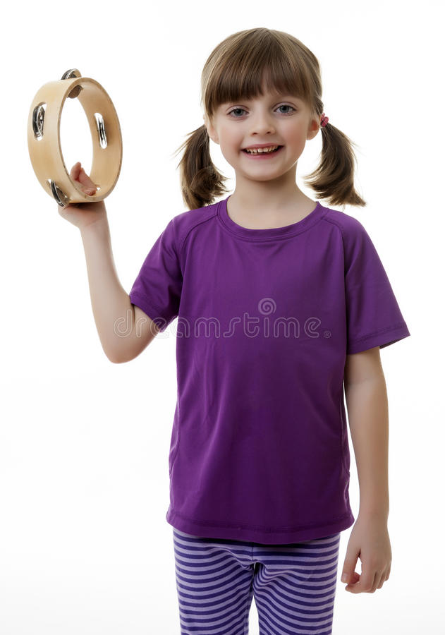 Little girl with tambourine. White background stock images