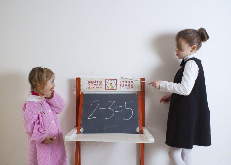 Little girl teaching mathematics stock photo
