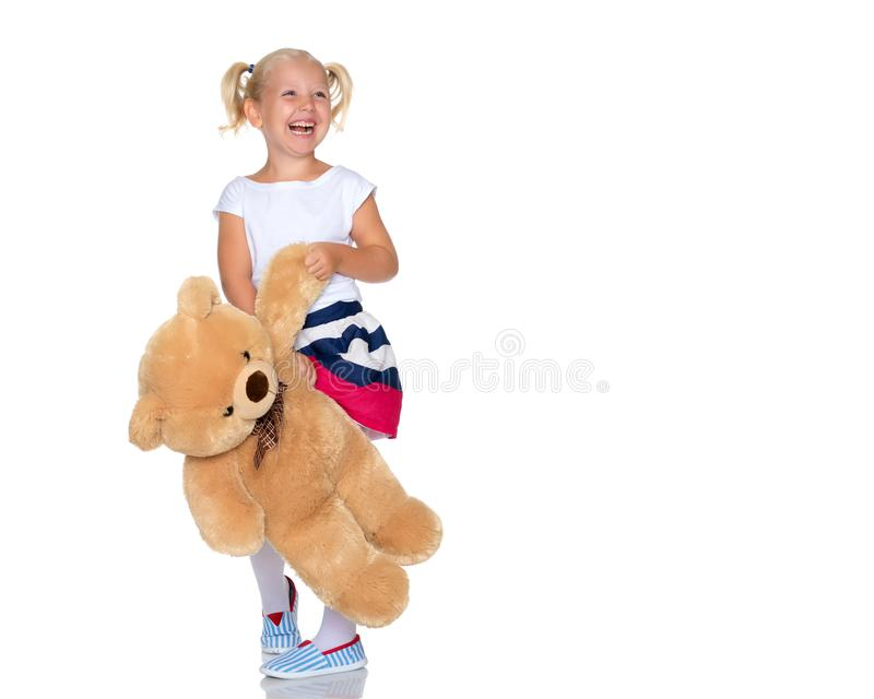 Little girl with teddy bear royalty free stock images