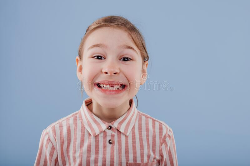 Little girl without teeth, stock photo