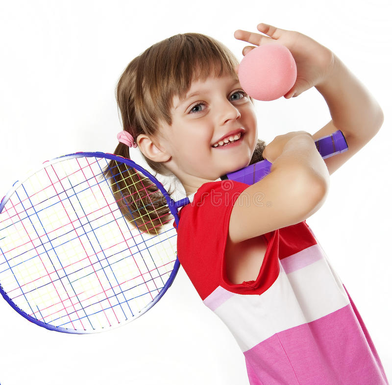 Little girl with a tennis racket and ball. Isolated on white background royalty free stock image
