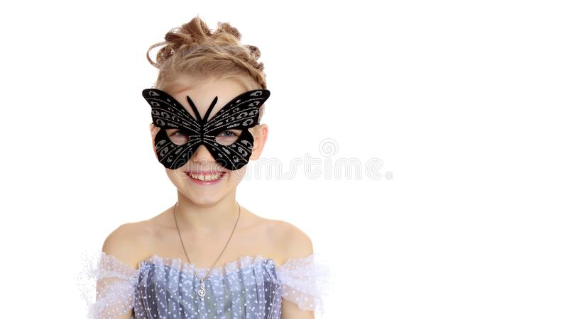 Little girl in the theatrical mask.Concept holiday, halloween, g stock photo