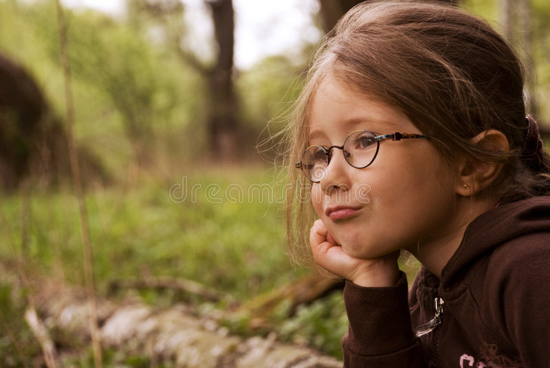 Little girl is thinking royalty free stock images