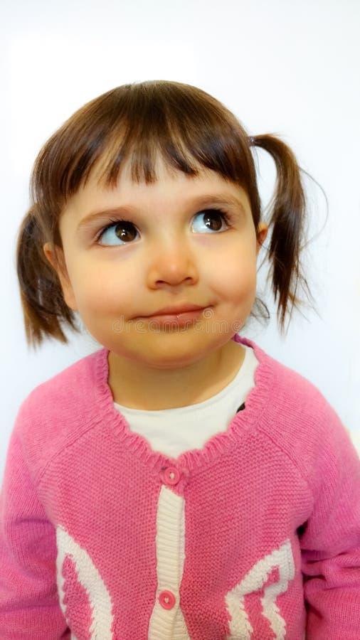 Little girl thinking stock photos