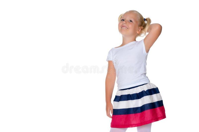 The little girl thinks. stock image