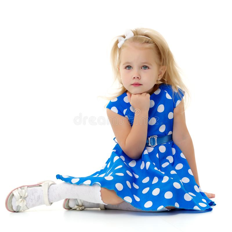 The little girl thinks. royalty free stock photos
