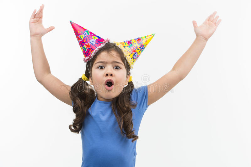 Little girl throwing hands up and shouting. royalty free stock photo