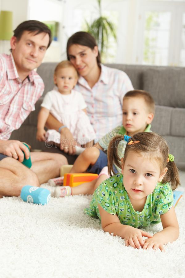 Little girl together with family at home royalty free stock photos
