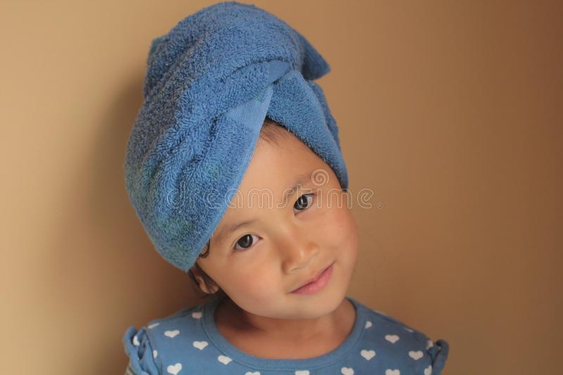 Little girl with towel wrap royalty free stock photo
