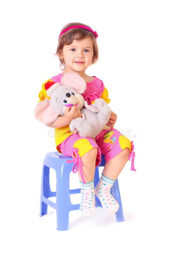 Little girl with toy royalty free stock photography