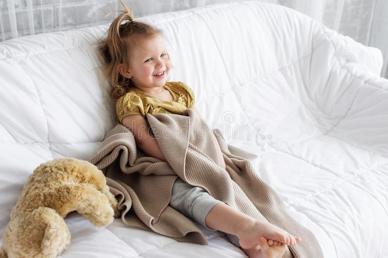 A little girl and a toy bear royalty free stock photography