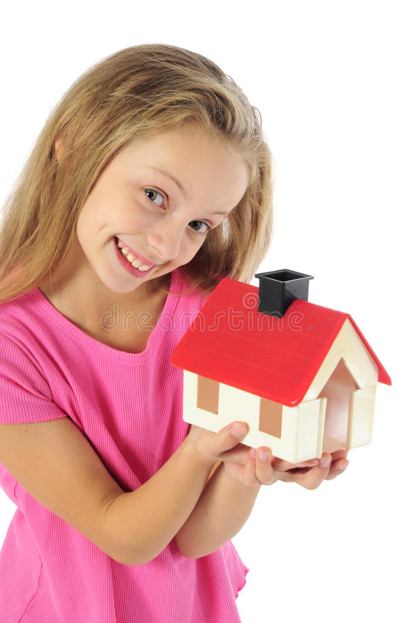 Little girl with toy house. Little girl holding toy house royalty free stock photo