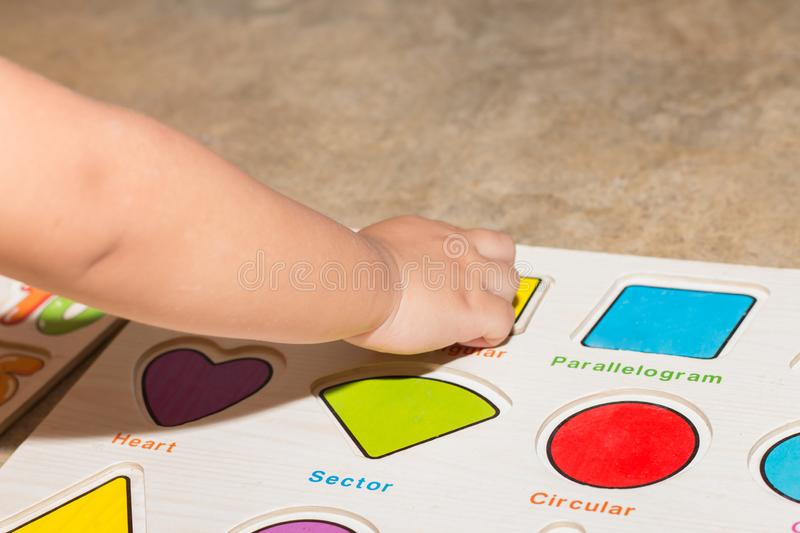 Little girl with toy numbers educational games at home, Board games for children modern learning,Girl learning counting number toy. Colored numbers math royalty free stock images