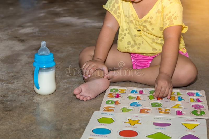 Little girl with toy numbers educational games at home, Board games for children modern learning,Girl learning counting number toy. Colored numbers math stock image