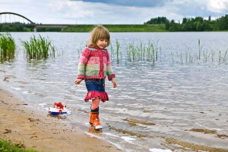 Download Little Girl With A Toy Ship Stock Image - Image: 15393161