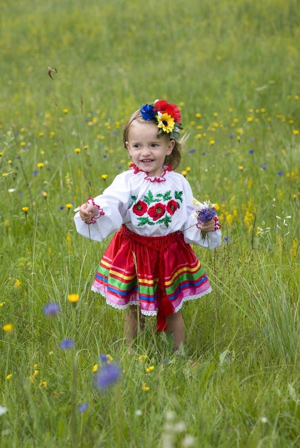 Little girl in traditional Ukrainian costume stock photography