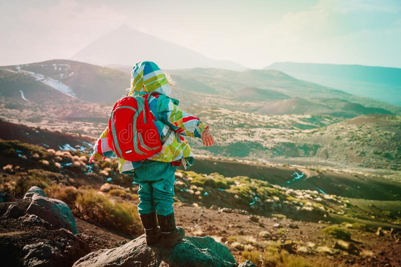 Little girl travel hiking in mountains, family travel in Tenerife stock images