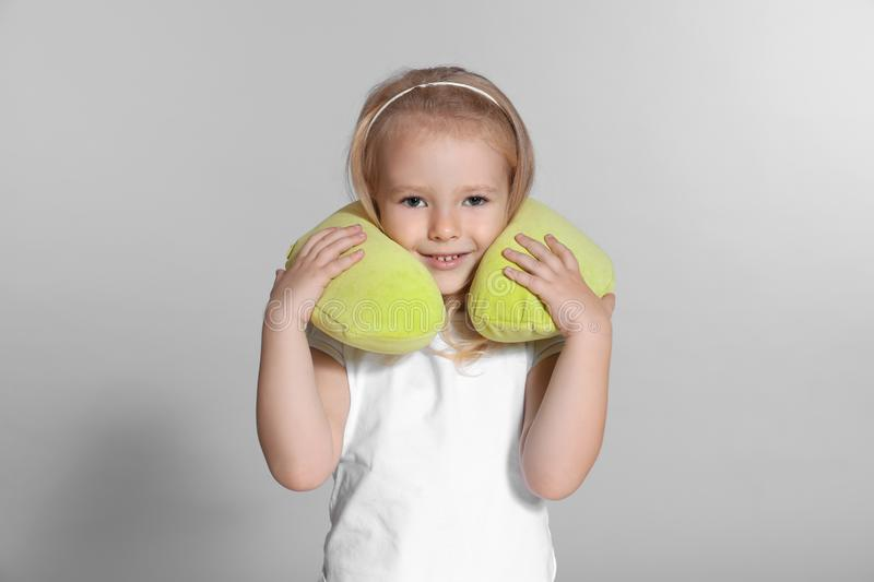 Little girl with travel pillow royalty free stock photo
