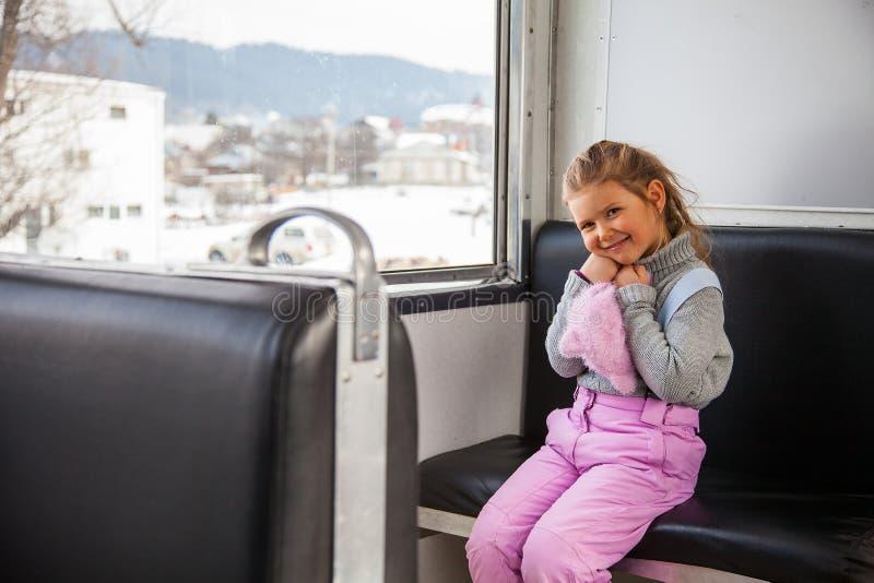 Little girl travelling by old train Kukushka between Borjomi and Bakuriani in Georgia stock images