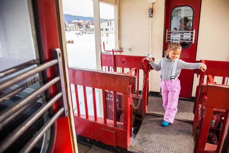 Little girl travellling by old train Kukushka in Georgia between Bakuriani and Borjomi stock image