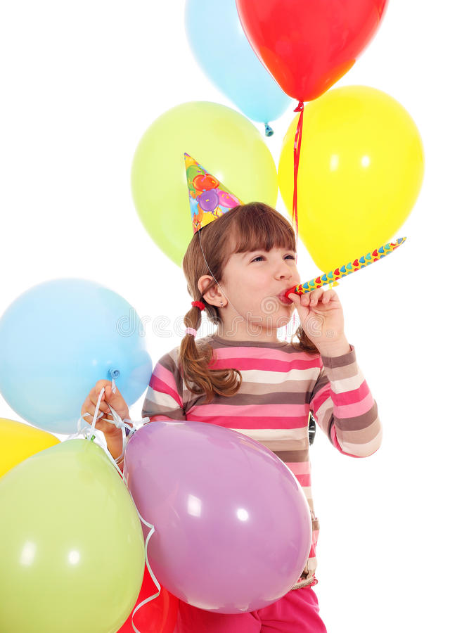 Little girl with trumpet hat and balloons birthday party. Happy little girl with trumpet hat and balloons birthday party royalty free stock photos