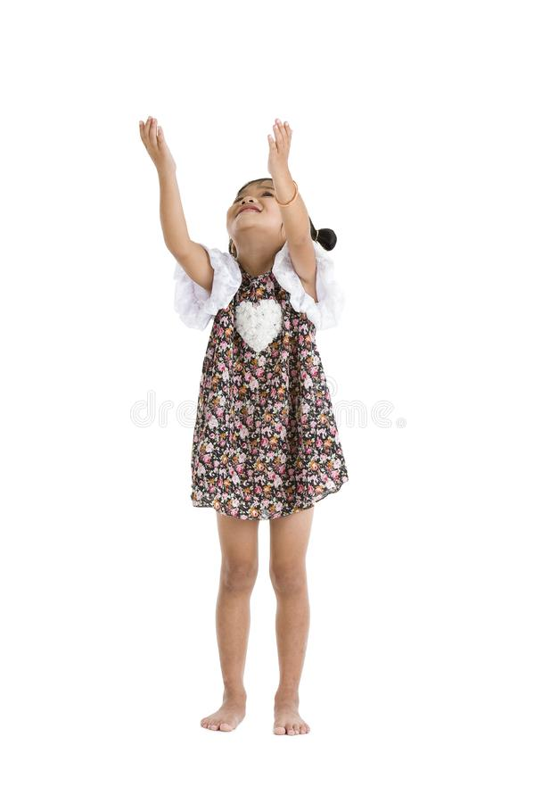 Little girl trying to catch something stock photography
