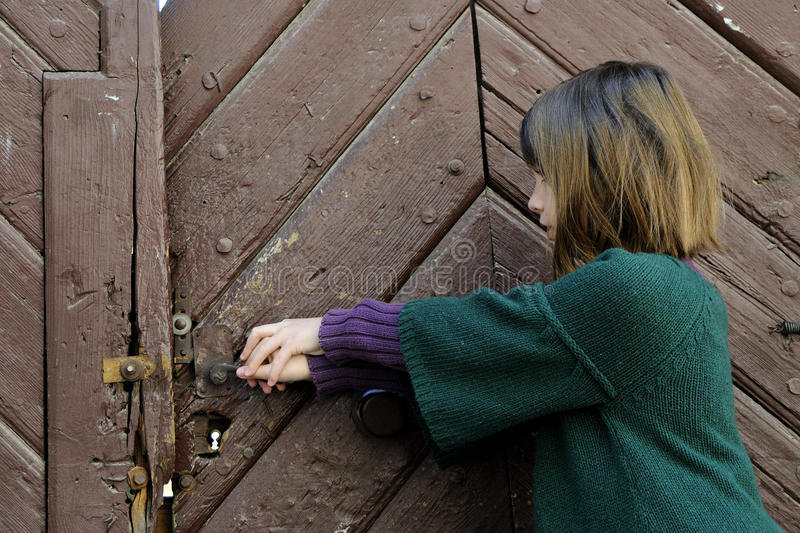 Download Little Girl Trying To Open Old Door Stock Photo - Image of collections, lonely: 13923150