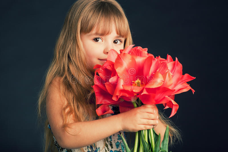 Download Little Girl With Tulips Bouquet Stock Photo - Image: 18840878