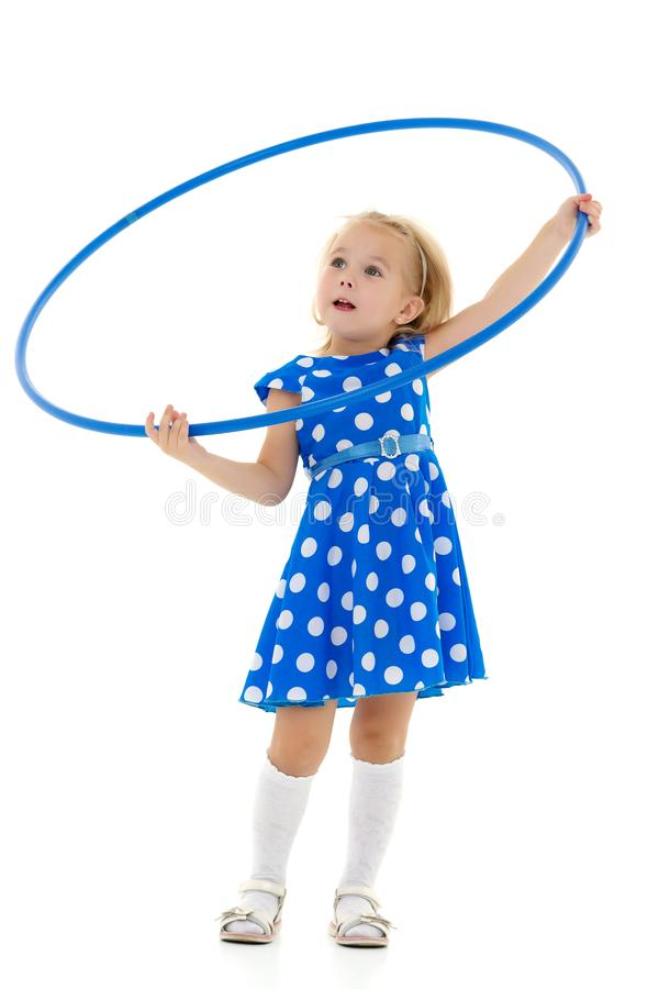 The little girl turns the hoop. royalty free stock photography