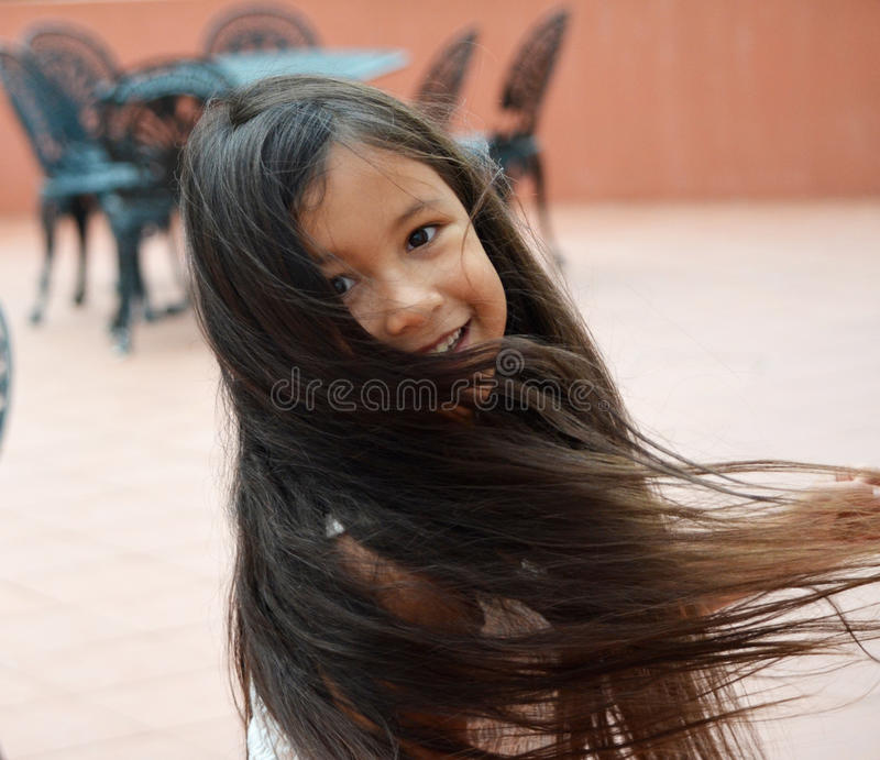 little girl twirling stock photography