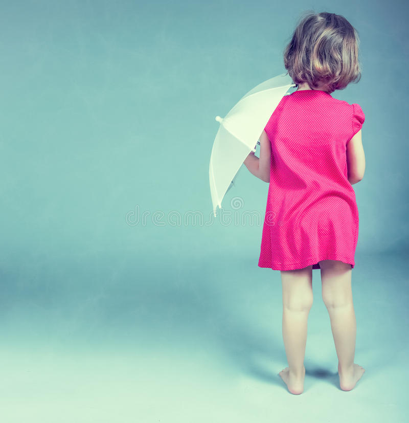 Download Little girl with umbrella stock image. Image of clothing - 24391713