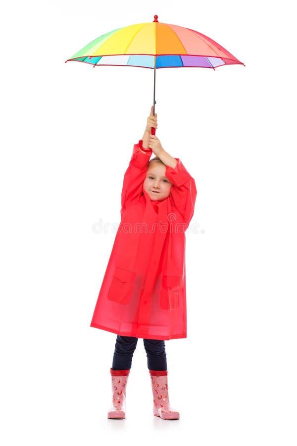 Little girl with umbrella. stock photo