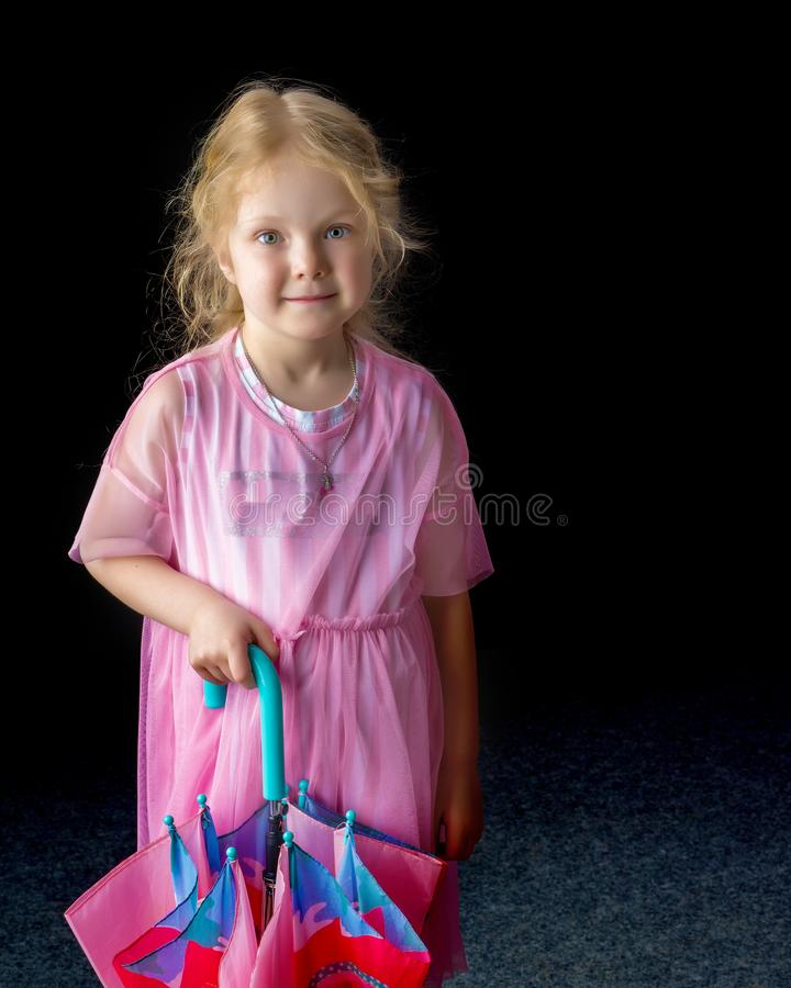 Little girl with umbrella. stock image