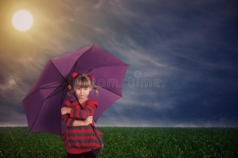 Little girl with an umbrella stock image