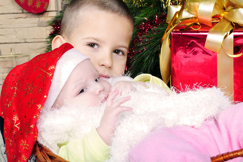 Little girl under the Christmas tree stock images