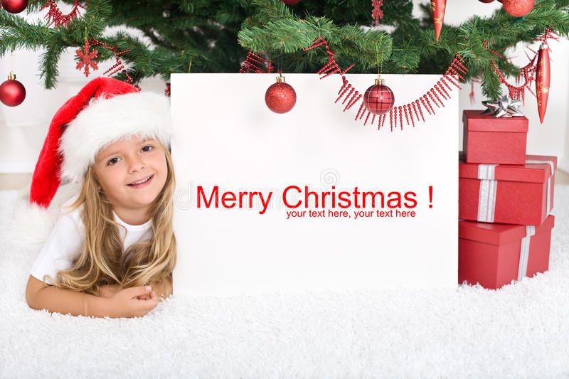 Little Girl Under The Christmas Tree With Banner Stock