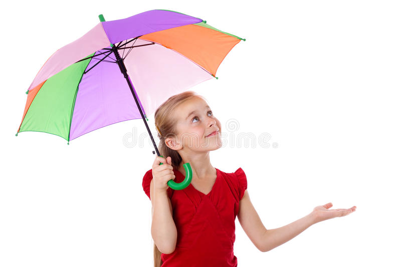 Little girl under umbrella looking up. Little girl standing under colorful umbrella and looking up, isolated on white royalty free stock image