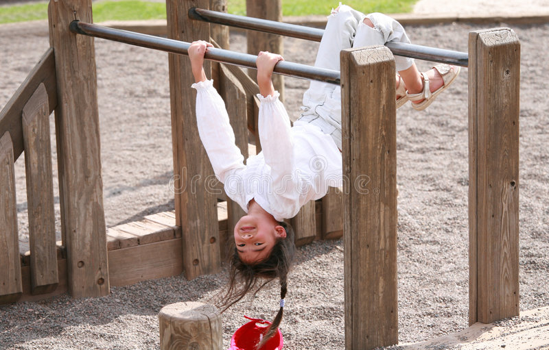 Download Little Girl Upside Down At Playground Stock Image - Image of asian, fitness: 6528205