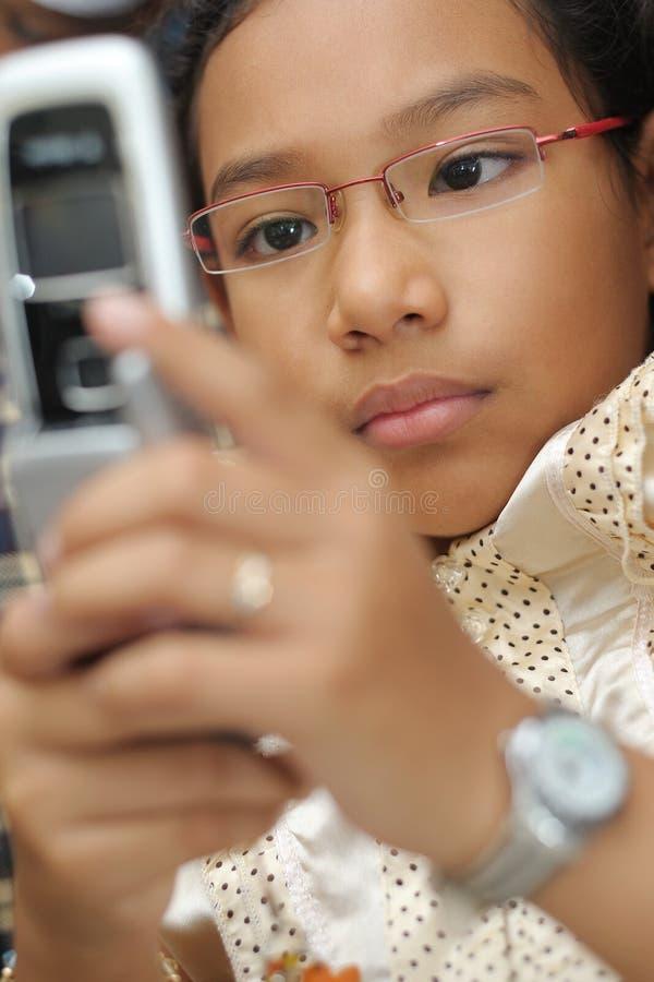Download Little girl use handphone stock photo. Image of beauty - 7590818