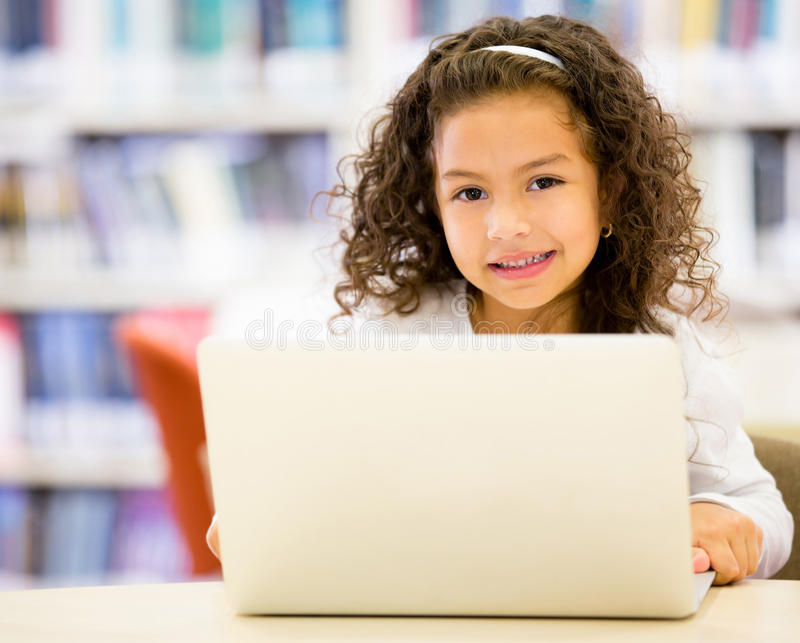 Download Little Girl Using  A Computer Stock Image - Image: 27838135