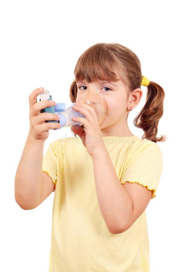 Little girl using an inhaler royalty free stock photos