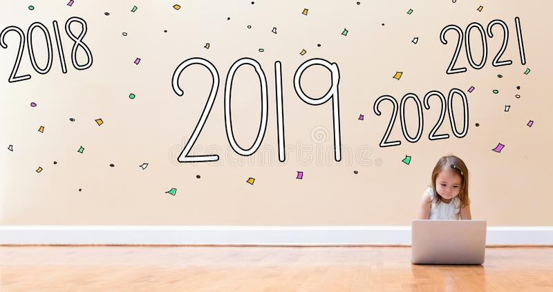 2019 with little girl using a laptop computer stock image