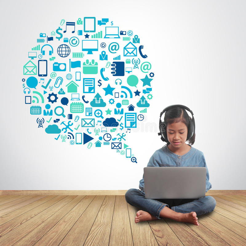 Little girl using laptop computer with technology set application icons. Speech bubble stock photos