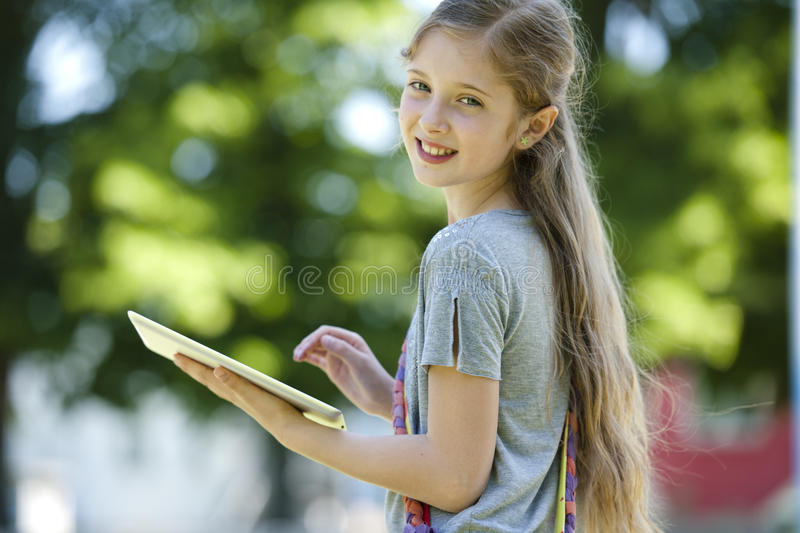 Little Girl Using PC Tablet Stock Photo