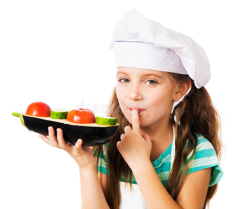 Little girl with vegetables stock image