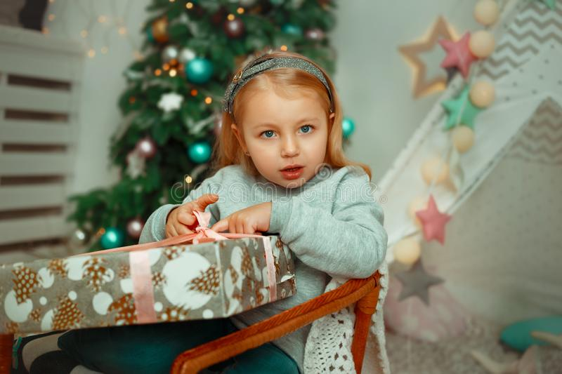 Little girl are very surprised to open christmas present stock photos