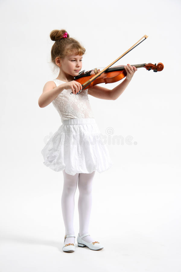 Little girl with violin stock photography